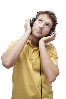 Young man wearing headphones, portrait - BMF00520