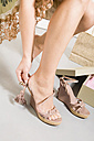 Woman in shoe shop, trying on shoes, low section - WESTF11116