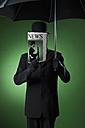 Man wearing bowler hat and umbrella - MAE01599