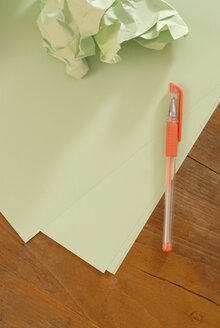 Letter paper, paper ball and pen, elevated view - KJF00036
