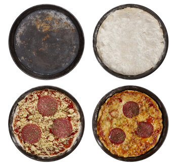 Baking Trays with raw pizza, pizza dough and prepared pizza elevated view - THF01044