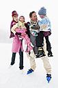 Italy, South Tyrol, Seiseralm, Family on frozen lake - WEST11732