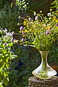 Austria, Salzburger Land, Cut flowers in glass vase on side table, close up - HHF02875