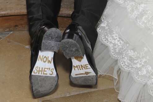 Germany, Bridal couple, Writing on shoes, close-up - AWD00338