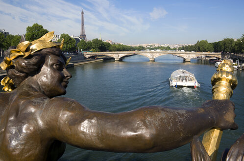 France, Paris, Seine, Pont Alexandre III, sculpture in foreground - PSF00171