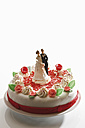 Wedding cake topper with bride and groom, elevated view - 11173CS-U