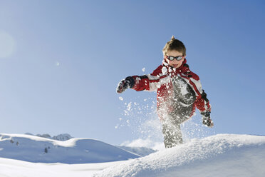 Italy, South Tyrol, Seiseralm, Boy (4-5) playing in snow - WESTF11402