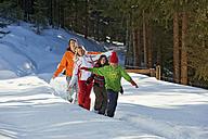 Austria, Salzburger Land, Altenmarkt, Family walking in snow - HHF02995