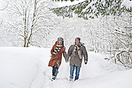 Austria, Salzburger Land, Altenmarkt, Couple walking in snow covered landscape - HHF02947