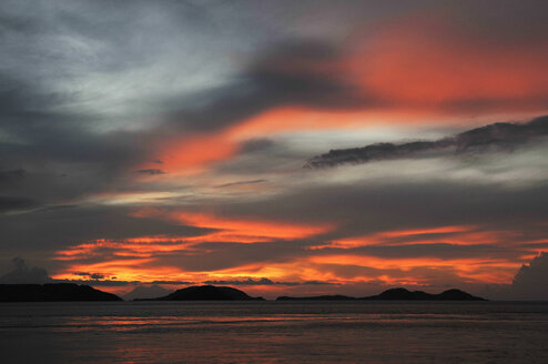 Asia, Indonesia, Sunset over Komodo Island. - MBF00943