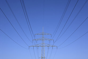 Germany, Bavaria, Power poles against blue sky - WWF00984