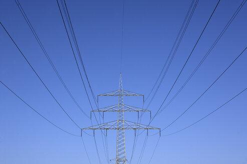 Germany, Bavaria, Power poles against blue sky - WWF00984