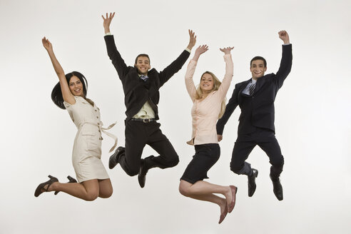 Businesspeople jumping in air, cheering - LDF00767