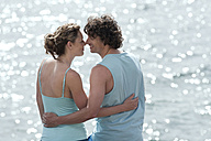 Spain, Mallorca, Couple standing at ocean, embracing - WESTF12669