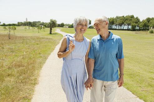 Spain, Mallorca, Senior couple having a walk, portrait - WESTF12916