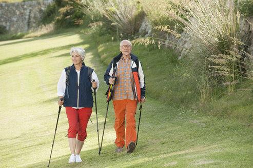 Spain, Mallorca, Senior couple nordic walking - WESTF12853