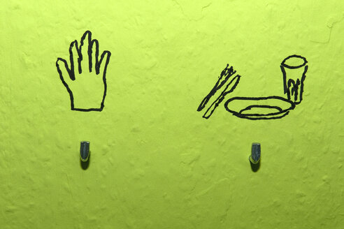 Hooks and drawing on green wall - AWDF00398