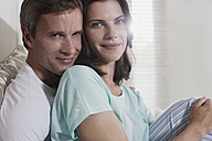 Germany, Hamburg, Couple sitting in bedroom, close-up - WESTF13076