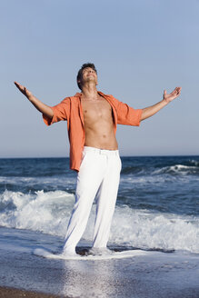 Turkey, Young man on beach with arms outstretched - RDF00974