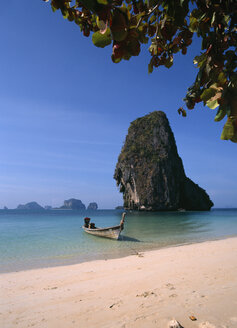 Asia, Thailand, Boat on beach, rock in background - PSF00360