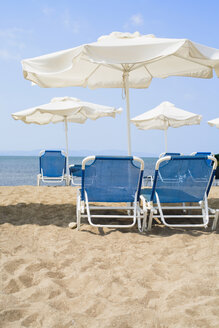Greece, Sun Loungers and sunshades on beach - JRF00135
