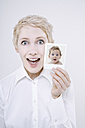 Woman holding baby photo, portrait - TCF01269