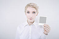 Woman holding polaroid picture - TCF01266