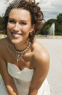 Germany, Bavaria, Bride in park, smiling, portrait, close-up - NHF01131