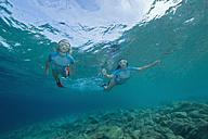 Croatia, Two girls (6-7) (10-11) snorkeling, portrait - GNF01170