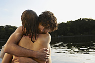 Germany, Berlin, Young couple embracing by Spree river, close-up - VVF00100