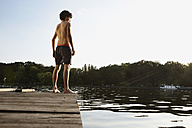 Germany, Berlin, Spree river, Young man standing on jetty - VVF00088