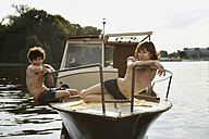 Germany, Berlin, Young couple on motor boat - VVF00070