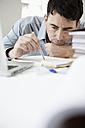 Businessman in office thinking, portrait - JRF00154
