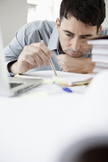 Businessman in office thinking, portrait - JRF00154