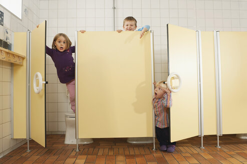Germany, Children in restroom, fooling about - RNF00205