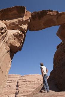 Man looking at rock formation - NHF01196