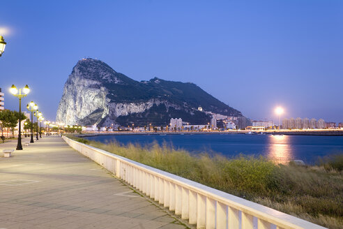 Spain, Andalusia, Rock of Gibraltar seen from La Linea at twilight - MSF02291