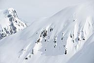 Austria, Arlberg, Man skiing downhill - MIRF00032