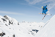 Austria, Arlberg, Man skiing downhill, doing jump - MIRF00029