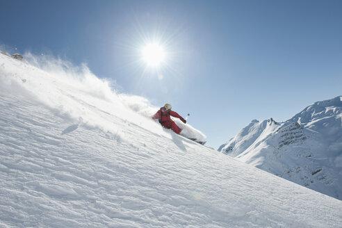 Austria, Arlberg. Man skiing downhill - MIRF00023