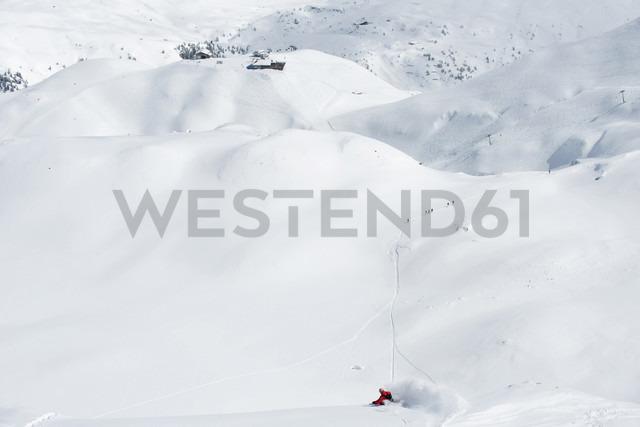 Austria, Arlberg, Man skiing downhill - MIRF00020