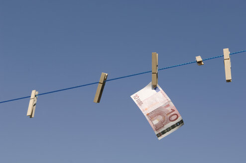 Germany, Euro banknote hanging on clothesline - CRF01842