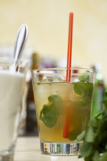 Mojito cocktail with mint and drinking straw, close-up - CHK00977