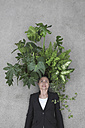 Businesswoman with foliage plants on head, smiling, portrait, elevated view - BAEF00068
