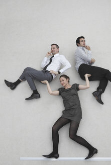 Businesswoman lifting two colleagues, smiling, portrait, elevated view - BAEF00050