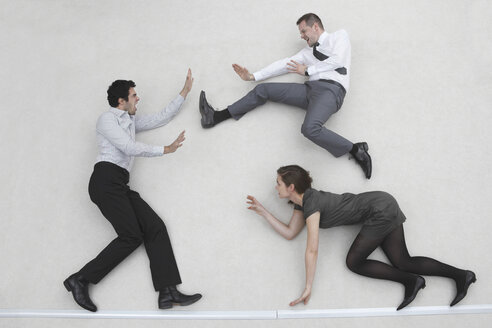 Three business people fighting, elevated view - BAEF00044