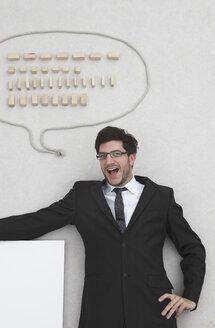 Businessman with speech balloon, portrait, elevated view - BAEF00005