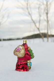 Santa claus figurine standing in snow, winter. - AWDF00489