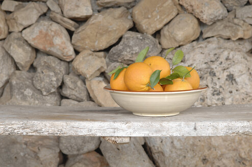 Bowl of oranges on bench. - ASF04050