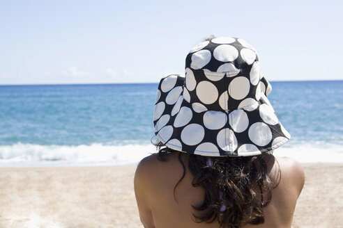 France, Corsica, Woman relaxing on beach, rear view - SSF00051
